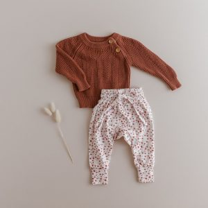 Rust coloured baby jumper with posy print harem pants