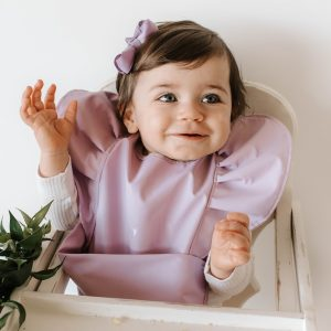 Baby girls bib in lavender on a little girl