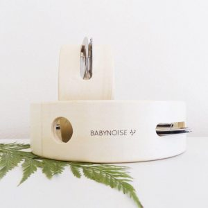 Two stacked tambourines in natural timber on white background with leaves