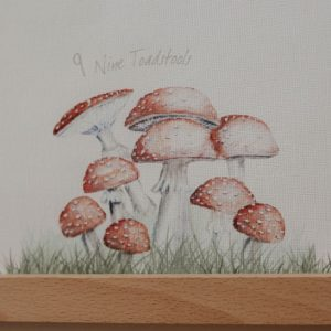9 red painted toadstools close up from woodland print