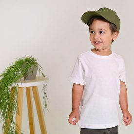 Little boy wearing olive cap and white t-shirt smiling