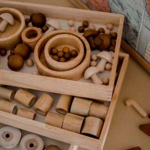 Montessori Nesting trays filled with little timber beads