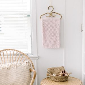 Baby diamond knit blanket hanging in nursery