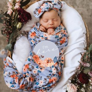 Milestone Card sitting on sleeping baby