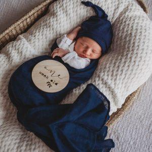Organic Cotton Muslin Wrap in navy on newborn baby