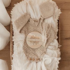 Cream Swaddle with cream fringe on baby bed