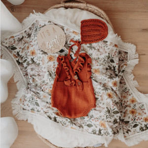 Mustard swaddle with floral print and cream fringe