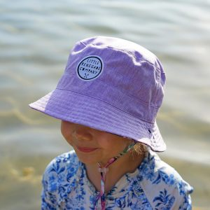 Child wearing pastel posies reversible bucket hat with lilac