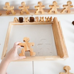 Playing with the montessori sand tray