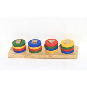 Shape sorting bar with bright coloured shapes stacked on it