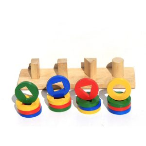 Shape sorting bar with coloured shapes in front of it