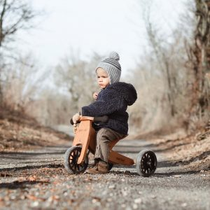 Little boy riding on tiny tot bike in winter