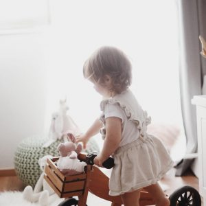 Tiny Tot bike with little girl about to ride it